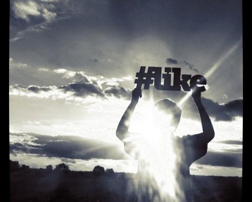 Google+ hashtags, man holding hashtag-like